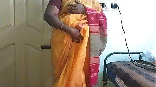 desi  indian nasty tamil telugu kannada malayalam hindi cheating wife vanitha wearing orange colour saree  showing thick boobs and shaved pussy press hard boobs press nip touching pussy masturbation