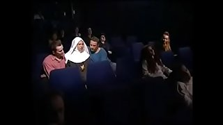 Nun in a cinema